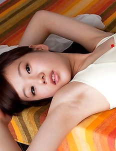 Kana Yuuki in white bath suit moves with grace and passion