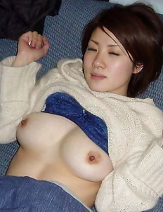 Gallery of a sexy Thai displaying her breasts