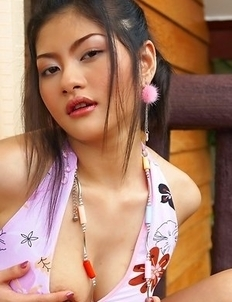 Mona Choi goes on the balcony and sits on the floor. She commences showing off her small tits and just playing around.