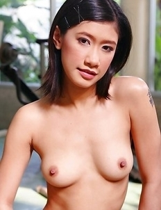 Pancake Sunisa bedns over and takes off her bra and panties. She exposes hard nipples with nice full breasts.