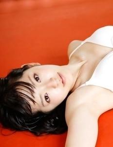 Airi Suzuki in bath suit enjoys petals all over her body