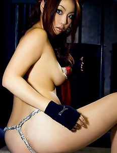 Risa Kasumi Asian exposes hot butt and playful boobs behind bars