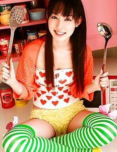Rina Akiyama Asian in long colorful socks enjoys some sweets