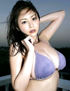 Anri Sugihara with huge melons shows curves at the sea