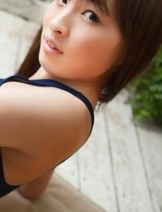 Maho Kiruma shows sexy curves in bath suit in her garden