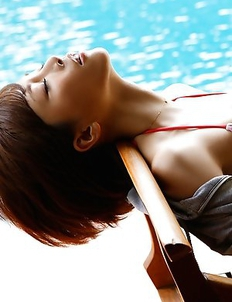 Yumiko Shaku with juicy boobies is romantic at the pool