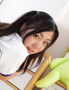 Miho Takai in sports outfit is sexy while playing with ball