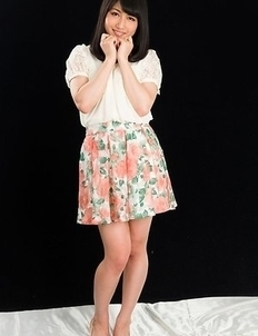 Cheerful teen Reo Saionji posing seductively in her stockings and stylish heels