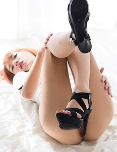 Short-haired stunner Chie Kobayashi strips and shows off her young pussy