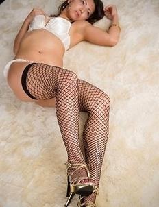 Fishnets-wearing beauty Misato Kagawa showing her ass in sexy white panties