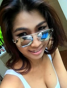 Sexy Thai lovely  Tittiporn showing her monster Tits