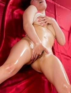 Oily beauty Ruru Sakurai teasing her hairy pussy while lying flat on her back