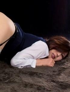 Flight attendant Yuu Kazuki posing in uniform, getting teased by a vibrator
