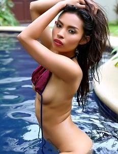 Oriental pornstar Amara Ranipas posing on the pool