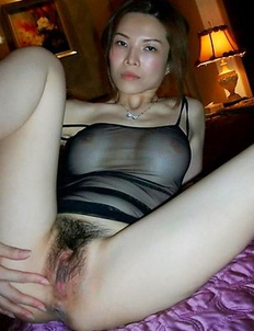 Chinese girlfriend exposes breasts and pussy