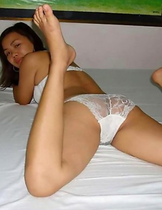 Naughty Thai chick flashes her hairy cunt