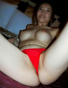 Japanese slut strips naked and spreads