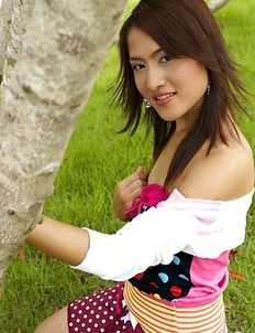 Young Asian cutie Milk Yada spreading pussy in outdoors