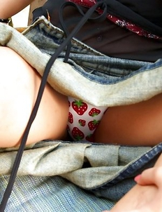 Sexy Asian babe Pang Piyatida show her upskirt and playing orange dildo