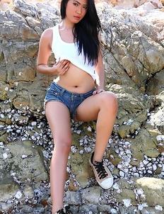 Hot Oriental bebe Varinda Pan posing on  beach