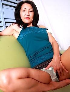 Asian MILF teasing her lovely cunt