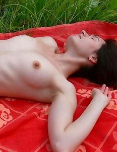 Asian girlfriend posing topless in the field