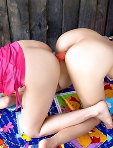 Two Asian lesbian Mona And Mind have fun each other with double dildo