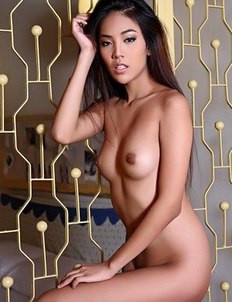 Longhaired Asian girl Arya takes off her underwear