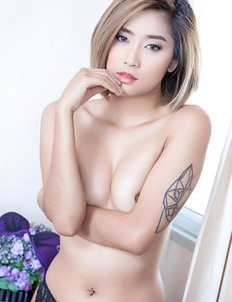 Blonde Asian Apple showing her hairy pussy