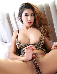 Busty Asian girl Laila sucks a pink dildo and puts it in her pussy
