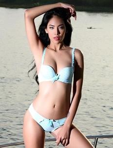 Skinny Asian Brunette Arya  is posing on a boat