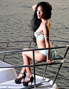Skinny Asian Brunette Arya  is posing on a boat