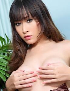 Beautiful Asian woman Mayrita entertains herself with a vibrator