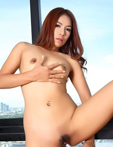 Hot and young Asian Lilah playing with glass dildo