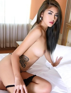 Hottest Asian Saipan in fishnet socks takes off her panties on the bed