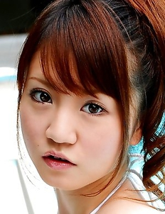 Lovely Japanese babe enjoys posing