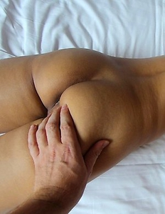 Brown Thai ass parted and pussy