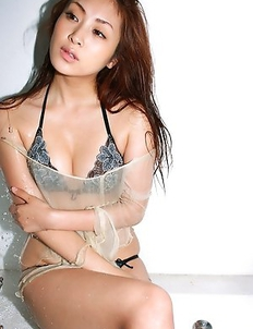 Natsuko Tatsumi is so hot that pours water on her curves