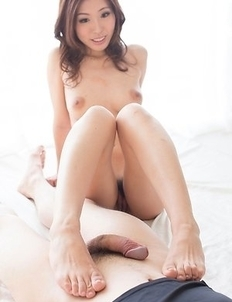 Rin Miura using her gorgeous feet to stroke this dude's hairy cock in a quasi-POV album
