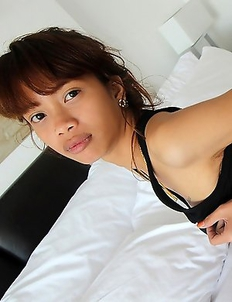 Tight and horny young Thai babe strips