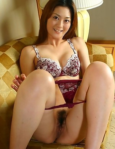 Naughty Japanese model Maya Tsubaki teases us with a nice upskirt and exposes her hairy pussy