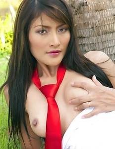 Check out the sexy Bella Yong as this hot babe rocks a red tie and panties.  She turns around and shows off her hot ass cheeks to the camera.