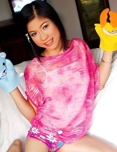 Gorgeous Bovi Ontida is in her bedroom and she is playing with her puppets.