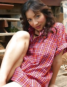 Annita Sang has on a sexy shirt and she is unbuttoning it to reveal her wonderful tits.