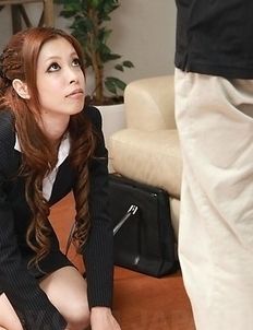 Asian Yurika in sexy office outfit kneels
