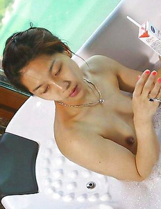 Chinese babe sucks on her lover's dick