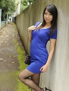 Asian Chihiro Kitagawa poses in dress outdoor