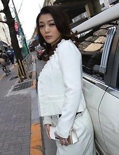 Minako Uchida shows sexy legs in stockings