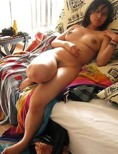 Kinky Asian girlfriend posing nude at home