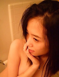 Hot asian teen with petite body gets totally naked